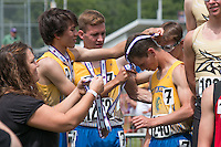 The St. Vincent 4x800-meter relay squad gets their medals after their 5th-place finish in the Class 2 4x800 in 8:26.83.
