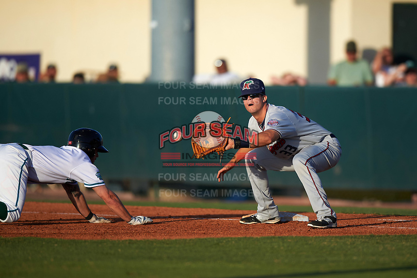 Fort Myers Miracle first baseman Trey Vavra (33) stretches for a pick off attempt throw as Blake Trahan (7) dives back to first base during a game against the Daytona Tortugas on April 17, 2016 at Jackie Robinson Ballpark in Daytona, Florida.  Fort Myers defeated Daytona 9-0.  (Mike Janes/Four Seam Images)