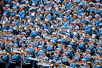 North Carolina marching band performs during the Meineke Car Care Bowl college football game at Bank of America Stadium in Charlotte, NC.