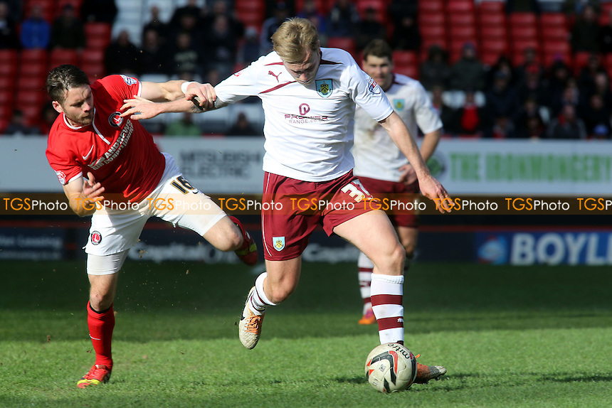 Burnley's Scott Arfield tries to shake off a challenge from Charlton's Rhoys Wiggins - Charlton Athletic vs Burnley - Sky Bet Championship Football at the Valley, London - 22/03/14 - MANDATORY CREDIT: Paul Dennis/TGSPHOTO - Self billing applies where appropriate - 0845 094 6026 - contact@tgsphoto.co.uk - NO UNPAID USE