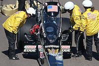Feb. 24, 2013; Chandler, AZ, USA; NHRA Safety Safari checks out top fuel dragster driver Brittany Force during the Arizona Nationals at Firebird International Raceway. Mandatory Credit: Mark J. Rebilas-