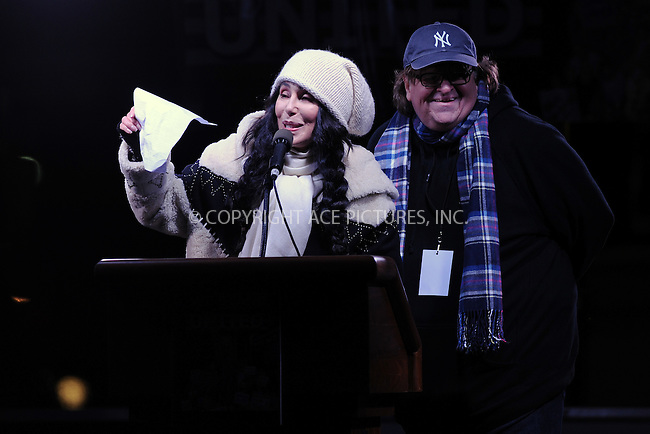 www.acepixs.com<br /> January 19, 2017  New York City<br /> <br /> Cher and Michael Moore during the We Stand United Rally outside Trump International Hotel &amp; Tower on January 19, 2017 in New York City.<br /> <br /> Credit: Kristin Callahan/ACE Pictures<br /> <br /> Tel: 646 769 0430<br /> Email: info@acepixs.com