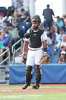 Alexis Olmeda (24) of the Hillsboro Hops in the field at catcher during a game against the Salem-Keizer Volcanoes at Ron Tonkin Field on July 26, 2015 in Hillsboro, Oregon. Hillsboro defeated Salem-Keizer, 4-3. (Larry Goren/Four Seam Images)
