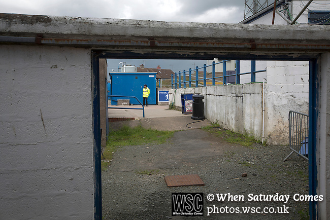 Queen of the South 2 Stranraer 0, 11/08/2015. Scottish Challenge Cup first round, Palmerston Park. A security guard on duty inside Palmerston Park, Dumfries, before Queen of the South hosted Stranraer in a Scottish Challenge Cup first round match. The game was the opening match of the season in a competition open to sides below the Scottish Premiership. Queen of the South won the match 2-0, watched by a crowd of 1229 spectators. Photo by Colin McPherson.