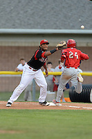Batavia Muckdogs first baseman Felix Munoz (27) takes a throw as Gustavo Martinez (24) runs through the bag during a game against the Williamsport Crosscutters on September 4, 2013 at Dwyer Stadium in Batavia, New York.  Williamsport defeated Batavia 6-3 in both teams season finale.  (Mike Janes/Four Seam Images)