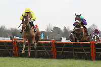 Race winner Farbreaga ridden by Jeremiah McGrath (L) in jumping action ahead of Hatters River ridden by Harry Derham in the Racing UK Novices Handicap Hurdle - Horse Racing at Kempton Park Racecourse