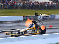 May 31, 2014; Englishtown, NJ, USA; NHRA top fuel driver Tony Schumacher during qualifying for the Summernationals at Raceway Park. Mandatory Credit: Mark J. Rebilas-