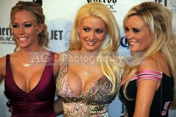"""Stars of """"The Girls Next Door"""" Kendra Wilkinson, Holly Madison, center, and Bridget Marquardt poseat Playboy's ninth annual """"Super Saturday Night""""  party in at Playboy's Desert Oasis and Resort in Chandler, Arizona Saturday February 2, 2008.   (Photo by Alan Greth)"""