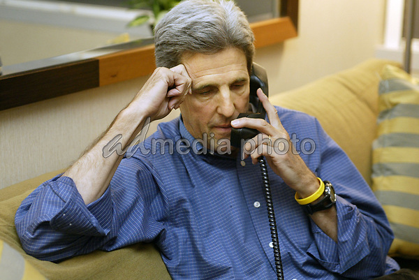05 October 2004- Cleveland, Ohio - John Kerry calls to congratulate his running mate, John Edwards, after the vice presidential debate in Cleveland, Ohio. Kerry watched from his hotel in Englewood, Colorado. Photo Credit by  Sharon Farmer/AdMedia.