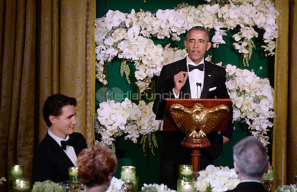 United States President Barack Obama makes remarks as Prime Minister Justin Trudeau of Canada looks on during a toast at the state dinner honoring the Prime Minister and Mrs. Sophie Gr&Egrave;goire Trudeau at the White House March 10, 2016 in Washington, DC. <br /> Credit: Olivier Douliery / Pool via CNP/MediaPunch