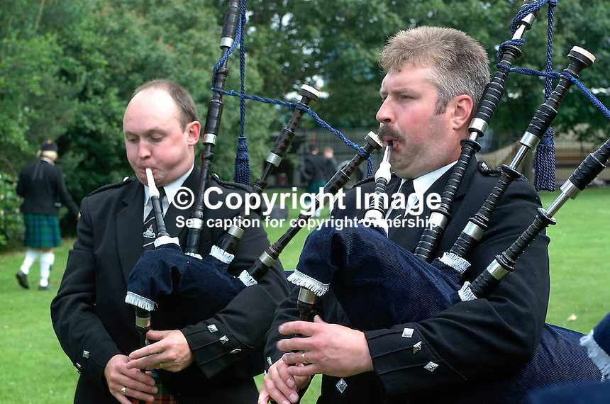 Pipe major Kenny Ferguson (right) gets in some last minute practice with a fellow member of Killadeas Pipe Band, from near Enniskillen, Co Fermanagh. Taken at European Pipe Band Championships on Saturday 22 June 2002 at Ormeau Park, Belfast. The competition drew competitors from North and South as well as England and Scotland..Ref: 20020622. ..Copyright Image from Victor Patterson, 54 Dorchester Park, Belfast, UK, BT9 6RJ..Tel: +44 28 9066 1296.Mob: +44 7802 353836.Voicemail +44 20 8816 7153.Skype: victorpattersonbelfast.Email: victorpatterson@mac.com.Email: victorpatterson@ireland.com (back-up)..IMPORTANT: If you wish to use this image or any other of my images please go to www.victorpatterson.com and click on the Terms & Conditions. Then contact me by email or phone with the reference number(s) of the image(s) concerned.