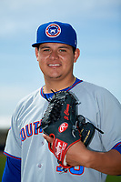 South Bend Cubs pitcher Jose Albertos (19) poses for a photo before the first game of a doubleheader against the Lake County Captains on May 16, 2018 at Classic Park in Eastlake, Ohio.  South Bend defeated Lake County 6-4 in twelve innings.  (Mike Janes/Four Seam Images)