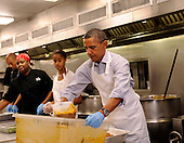 United States President Barack Obama with daughter Malia Obama, and, from left, Jeffrey Ragsdale and Jamillah Linkins, participate in a service project at DC Central Kitchen, on Saturday, September 10, 2011, in Washington, DC. .Credit: Leslie E. Kossoff / Pool via CNP