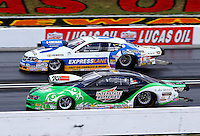 Sept. 2, 2013; Clermont, IN, USA: NHRA pro stock driver Mike Edwards (near) races alongside Allen Johnson during the US Nationals at Lucas Oil Raceway. Mandatory Credit: Mark J. Rebilas-