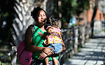 A woman and her daughter walk home after a session of the early intervention program of Piña Palmera, a center for community based rehabilitation for people living with disabilities in Zipolite, a town in Oaxaca, Mexico.