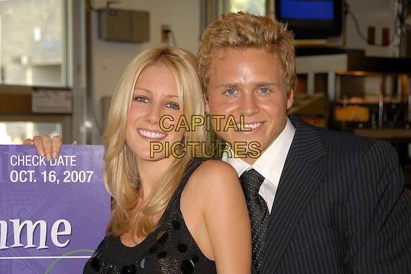 "HEIDI MONTAG & SPENCER PRATT.Taco Bell Provides ""Reality Check"" on Global Hunger Issue.for World Hunger Relief Week at Taco Bell on Western Ave., Los Angeles, California, USA..October 16th, 2007.headshot portrait black couple .CAP/ADM/BP.©Byron Purvis/AdMedia/Capital Pictures."