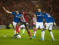 Lincoln City's John Akinde battles with Everton's Michael Keane<br /> <br /> Photographer Andrew Vaughan/CameraSport<br /> <br /> The Carabao Cup Second Round - Lincoln City v Everton - Wednesday 28th August 2019 - Sincil Bank - Lincoln<br />  <br /> World Copyright © 2019 CameraSport. All rights reserved. 43 Linden Ave. Countesthorpe. Leicester. England. LE8 5PG - Tel: +44 (0) 116 277 4147 - admin@camerasport.com - www.camerasport.com