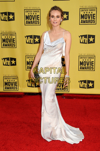 DIANE KRUGER .15th Annual Critics' Choice Movie Awards - Arrivals held at the Hollywood Palladium, Hollywood, California, USA, 15th January 2010..full length long maxi dress  white cream silk  black clutch bag bracelets .CAP/ADM/BP.©Byron Purvis/Admedia/Capital Pictures
