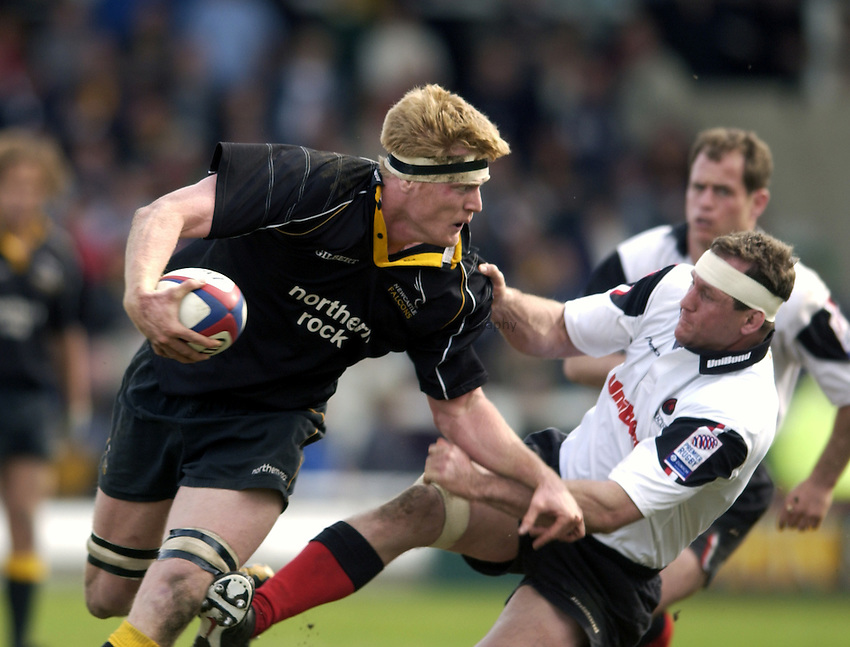 .Photo. Jed Wee.Newcastle Falcons v Saracens, Zurich Premiership, Kingston Park, Newcastle. 04/05/2003..Newcastle's Hugh Vyvyan (L) with Saracens' Richard Hill.