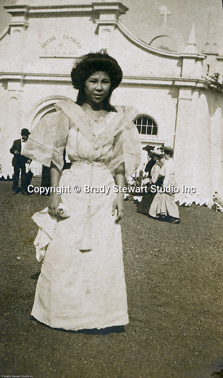 St Louis MO:  View of a filipino woman greeting visitors at Philippine Village during the Louisiana Purchase Exposition.