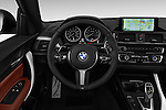 Car pictures of steering wheel view of a 2016 BMW 2 Series M235i 2 Door Coupe Steering Wheel