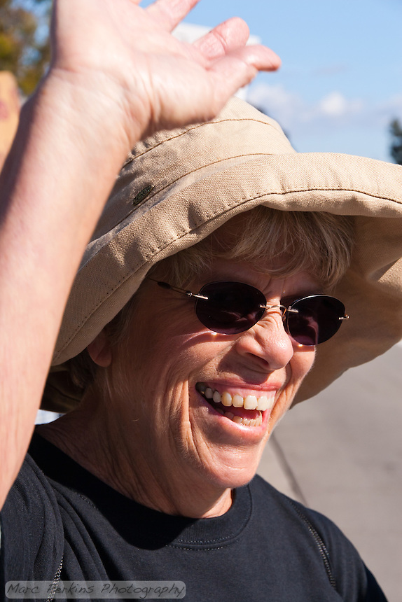 Susan smiles and waves at a passer by as she holds a sign at the Occupy Orange County, Irvine camp on November 5.
