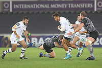 Patricio Fernandez of Clermont is tackled by Sam Davies of Ospreys during the Champions Cup Round 1 match between Ospreys and Clermont at The Liberty Stadium, Swansea, Wales, UK. Sunday 15 October 2017