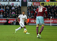 Pictured L-R: Wayne Routledge of Swansea against Carl Jenkinson of West Ham. Saturday 10 January 2015<br />