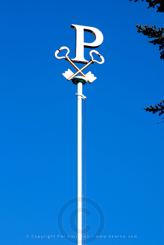 """The Petrus """"P"""" on the flag pole with Saint Peter's keys at the Chateau Petrus in Pomerol, owned by the Moueix family"""