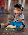 Gael Oliviera eats a meal at the office of Caritas in Manaus, Brazil. The 17-month old boy participates in an educational and cultural program to combat sexual abuse and exploitation among at-risk children sponsored by the Catholic Church's social ministry. <br /> <br /> Written parental consent obtained.