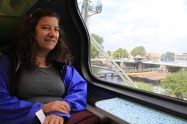 Beth riding the train from Haarlem to Amsterdam, Holland, Netherlands.