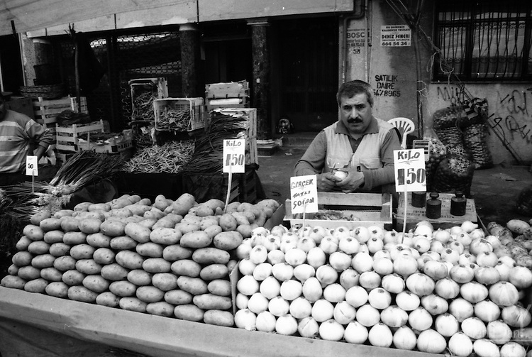 Potatoes and onions stand at a street market of the popular area named Zeytinburnu, Istanbul.