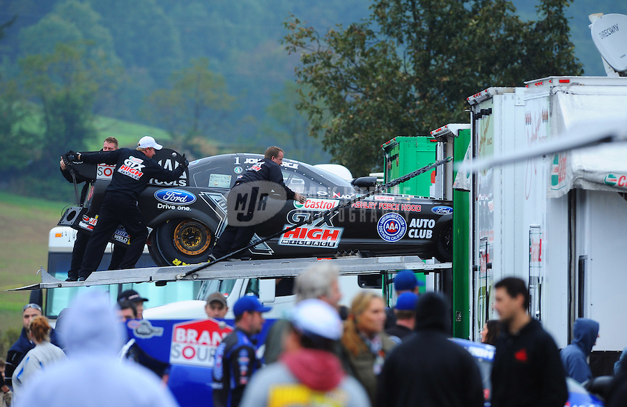 Oct. 2, 2011; Mohnton, PA, USA: NHRA crew members for funny car driver John Force put his funny car into the hauler during the Auto Plus Nationals at Maple Grove Raceway. Mandatory Credit: Mark J. Rebilas-