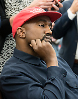 Kanye West listens as he meets with United States President Donald J. Trump and Jim Brown, right, in the Oval Office of the White House in Washington, DC on Thursday, October 11, 2018.<br /> Credit: Ron Sachs / CNP /MediaPunch