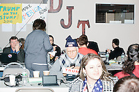 People work the phone bank, including Cesare Del Vaglio, of Sheffield, Mass., (blue hat) at the campaign headquarters of Republican presidential candidate Donald Trump in Manchester, New Hampshire, on the day of the primary, Tues., Feb. 9, 2016. Donald Trump won the primary.