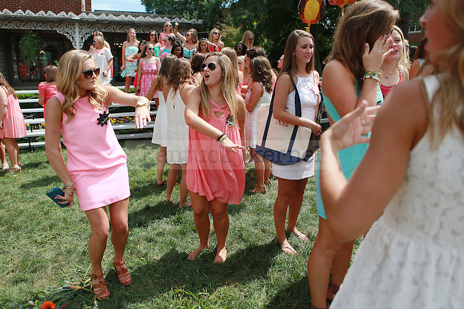 Members of Chi Omega dance at sorority bid day in Lexington, Ky., on Friday, August 21,  2015. Photo by Emily Wuetcher | Staff