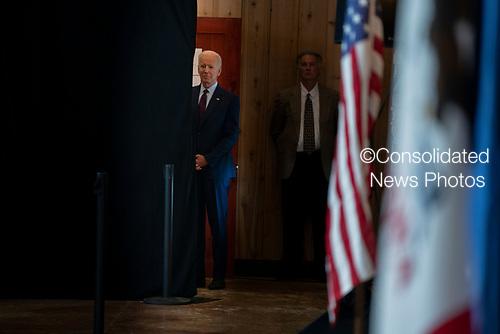 2020 Democratic Presidential candidate, Joe Biden, waits to speak at a campaign event in Burlington, Iowa on Wednesday, August 7, 2019. Biden is kicking off a 4 day tour of Iowa. Credit: Alex Edelman / CNP