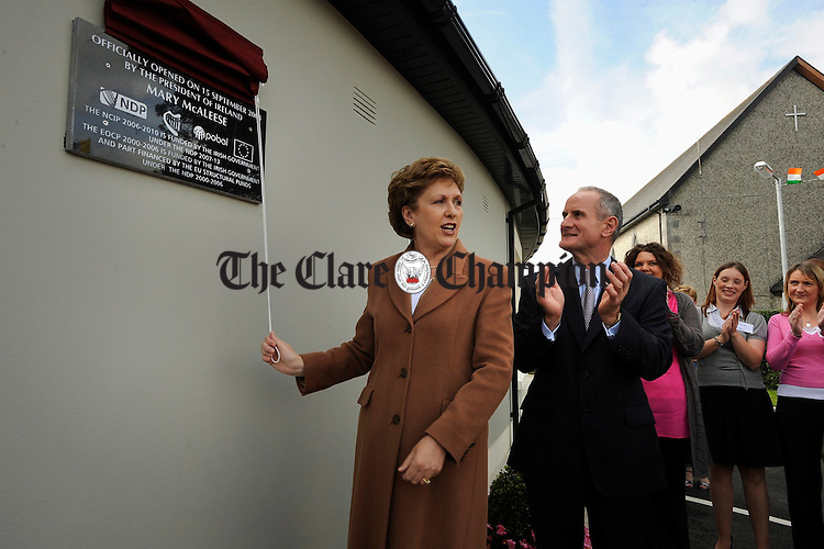 President Mary Mc Aleese unveils a plaque watched by her husband Martin Mc Aleese at the official opening of the Ark Creche at Inagh. Photograph by John Kelly.