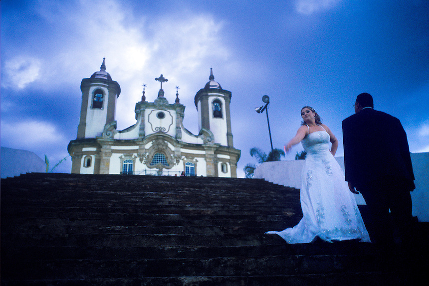 A bride poses for pre-nuptual photos near the Church of Nossa Senhora da Conceição, or Our Lady of the Immaculate Conception, in Ouro Prêto, Brazil. Ouro Prêto boasts 19 churches from the Baroque and Rococco schools. Brazil's interior state of Minas Gerais, once a colonial mining capitol for the Portuguese crown, has changed little in appearance since the 18th century. With the help of laws to preserve its baroque architecture, the state's sky is scraped at every turn by 250-year-old church steeples, and lined with cobblestones. (Kevin Moloney for the New York Times)