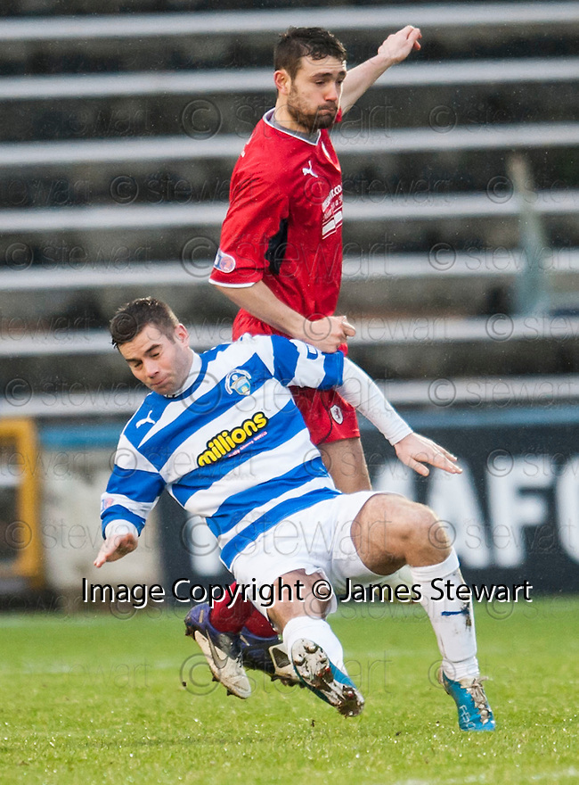 Morton's Peter MacDonald is caught by Raith's Laurie Ellis.