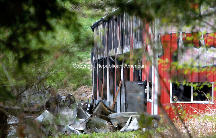 WASHINGTON, CT. 02 May 2012-050212SV01-State police and firefighters investigate a fire at the town garage on Blackville Road in Washington Wednesday. Firefighters were called to the scene around 4:30 a.m. .Steven Valenti Republican-American
