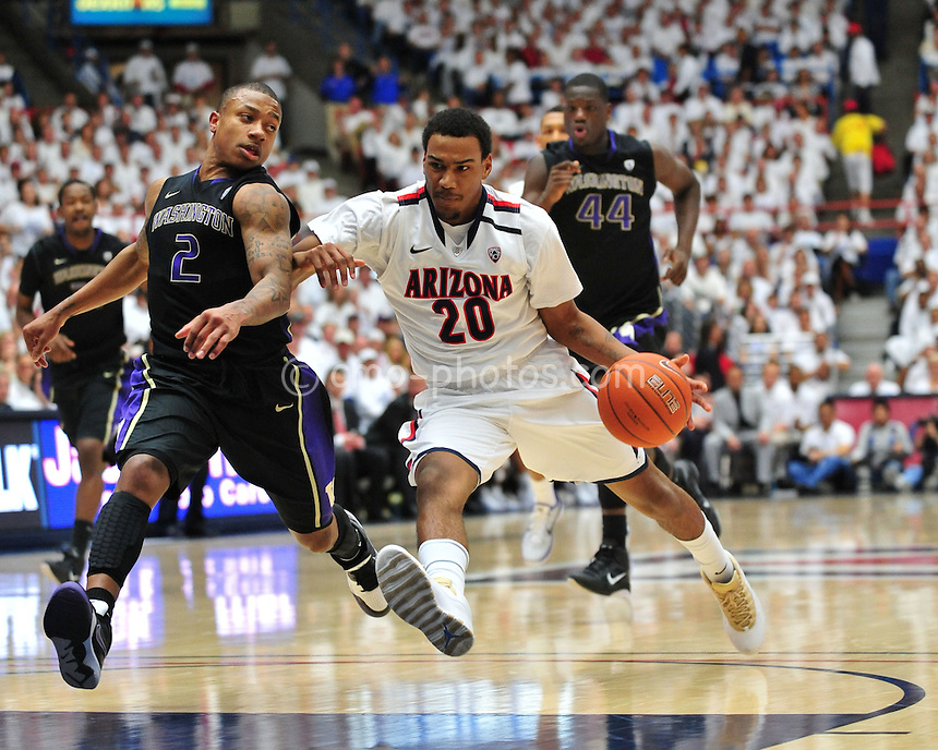 Feb 19, 2011; Tucson, AZ, USA; Arizona Wildcats guard Jordin Mayes (20) leans into the back of Washington Huskies guard Isaiah Thomas (2) in the 1st half of a game at the McKale Center.
