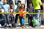 Children wait for the egg hunt to begin during the 7th Annual Easter Fiesta at Western Nevada College Saturday, March 26, 2016. The event, hosted by the Association of Latin American Students, had 3 separate egg hunts, face painting, limbo, musical chairs, ring toss, sack races, bowling,  food, music and a piñata.  <br />