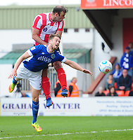Lincoln City's Matt Rhead vies for possession with Macclesfield Town's Neill Byrne<br /> <br /> Photographer Chris Vaughan/CameraSport<br /> <br /> Vanarama National League - Lincoln City v Macclesfield Town - Saturday 22nd April 2017 - Sincil Bank - Lincoln<br /> <br /> World Copyright &copy; 2017 CameraSport. All rights reserved. 43 Linden Ave. Countesthorpe. Leicester. England. LE8 5PG - Tel: +44 (0) 116 277 4147 - admin@camerasport.com - www.camerasport.com