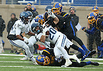BROOKINGS, SD - DECEMBER 3:  Matt Gudzak #20 from Villanova is brought down by a pair of defenders from South Dakota State University during their second round playoff game Saturday afternoon at Dana J. Dykhouse Stadium in Brookings, SD. (Photo by Dave Eggen/Inertia)