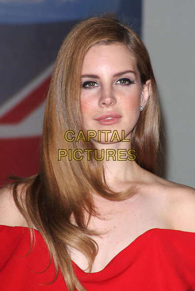 Lana Del Rey.The Brit Awards 2012 arrivals, O2 Greenwich, London, England 21st February 2012.Brits headshot portrait red off the shoulder .CAP/ROS.©Steve Ross/Capital Pictures