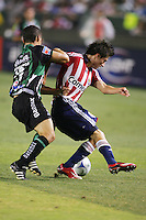 Chivas USA forward Jorge Flores (19) attempts to move past Santos defender Rafael Figueroa (19). Chivas USA defeated the Santos of Laguna 1-0 during the 1st round of the 2008 SuperLiga at Home Depot Center stadium, in Carson, California on Wednesday, July 16, 2008.