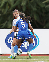 Portland Thorns FC forward Alex Morgan (13) takes on a defender. In a National Women's Soccer League (NWSL) match, Portland Thorns FC (white/black) defeated Boston Breakers (blue), 2-1, at Dilboy Stadium on July 21, 2013.