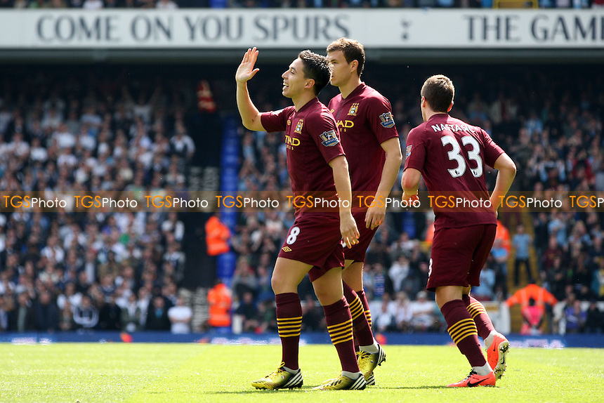 Samir Nasri of Manchester City is congratulated after scoring the opening goal - Tottenham Hotspur vs Manchester City at the White Hart Lane Stadium - 21/04/13 - MANDATORY CREDIT: Dave Simpson/TGSPHOTO - Self billing applies where appropriate - 0845 094 6026 - contact@tgsphoto.co.uk - NO UNPAID USE