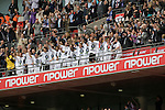 Swansea players are presented with the winners' trophy after the Npower Championship play-off final between Reading (blue) and Swansea City at Wembley Stadium. The match was won by Swansea by 4 goals to 2 watched by a crowd of 86,581. Swansea became the first Welsh team to reach the top division of English football since they themselves played there in 1983.